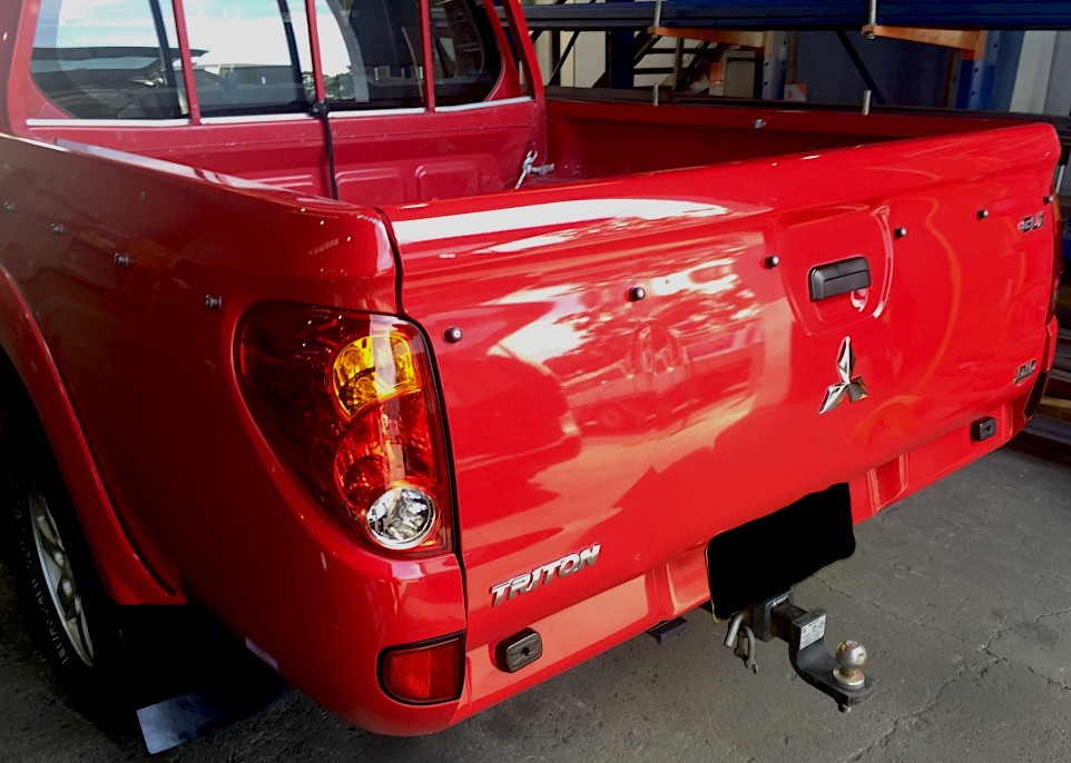 Mobile car detailing near me - Results on a red triton detailed in Maitland NSW