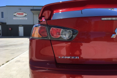 Rear of a detailed red lancer in Maitland NSW