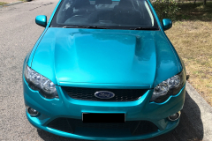 Front view of aqua car that has been detailed by Maitland Auto Detailing