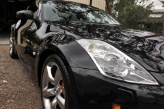 Side angle view of a black 350z that has been paint corrected by Maitland Auto Detailing - car detailing near me