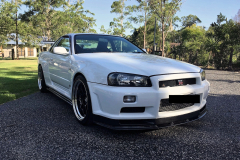 Front view of a white Skyline that has been protected by Maitland Auto Detailing - car detailing near me in Port Stephens NSW