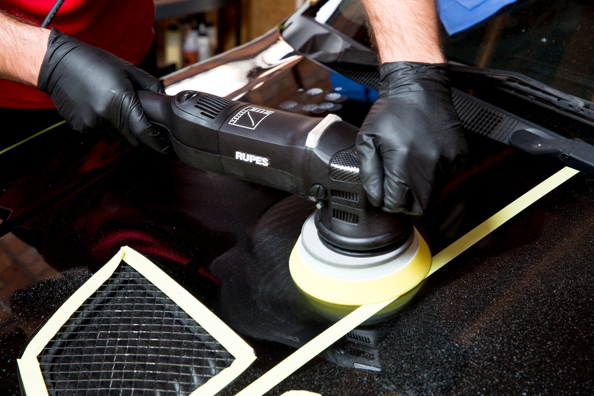 Mobile Car Detailing Services - Maitland Auto Detailing buffing the exterior paintwork of a black car